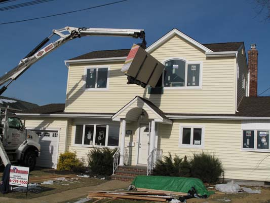 Great additions construction company long island for Front to back split house